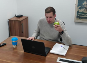 Pete eating an apple from eat fruit.co.uk